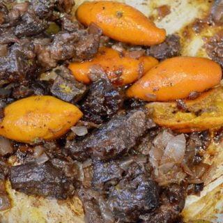 Braised goat and mandarin orange on toasted baguette