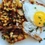 Simple shredded duck hash and eggs